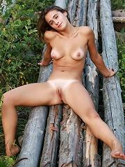 Tanlined brunette beauty posing naked